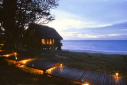 The romantic cottages of the Anjajavy Hotel right by the tropical beach offer a stunning view.