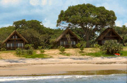 Some of the comfortable cottages of the Anjajavy Hotel are right by the beach.