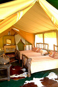 Spacious tents with comfortable beds after an exciting day at the Mara Porini Camp